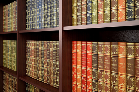 This a stock photo. An up close view of old books on a bookshelf.