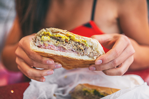 A stock photo. A zoomed in view of a traditional Cuban sandwich.