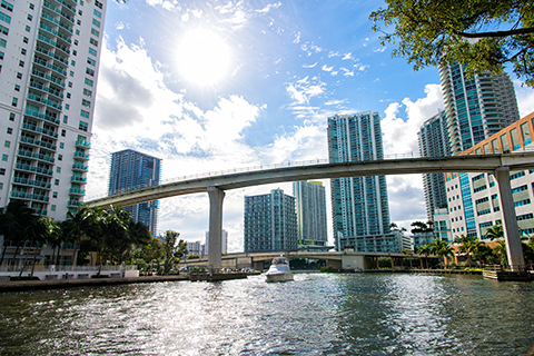 A stock photo. A cityscape view from the Miami River.