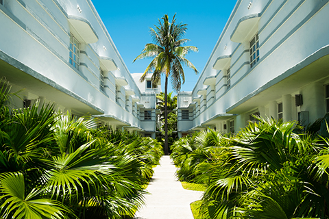 A stock photo. The courtyard of an apartment community in the art deco district of Miami Beach, Florida.