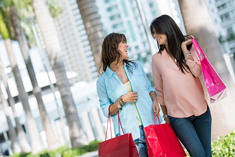 A stock photo. Two women shopping in downtown Miami.