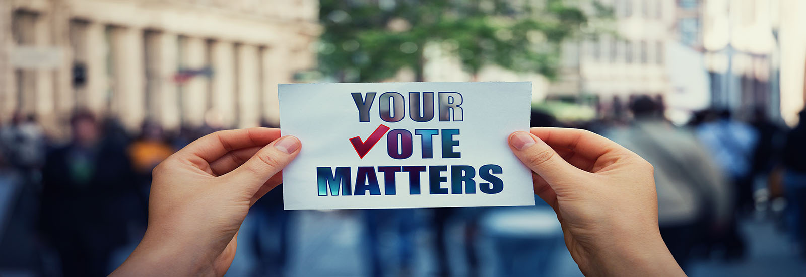 "This is a stock photo. An up close image of a sign reading ""your vote matters."""